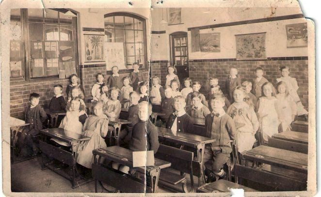 Elm Grove classroom, circa 1915 or earlier. My Mother, Ellen Ann Terry born Jan 1906, is second left in front. | From the private collection of Dennis Parrett