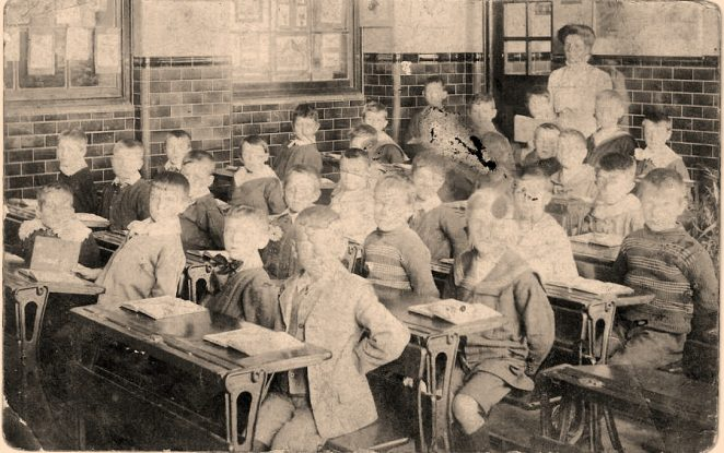 Elm Grove classroom, circa 1910 or earlier. My Uncle, Albert Terry who was older than my Mother, is I believe third from left in front. | From the private collection of Dennis Parrett