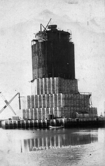 Click on the image and it will open in new window: click again for full-size. Base of one of the two stacks being brought into Shoreham harbour | From the private collection of Alan Dearling