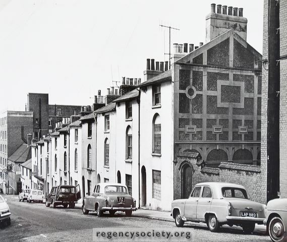 Houses on the west side of Spring Street, Nos. 5-11 boarded up prior to demolition, 19 June 1966 | Image reproduced with kind permission of The Regency Society and The James Gray Collection