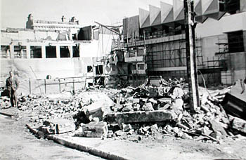 Rear view of the demolition of the Sports Stadium, 1965. This photo shows George Miller on the site of the Sports stadium in its last days of demolition in 1965. The view shows the Stadium facing east and virtually all that remains of the rink is the