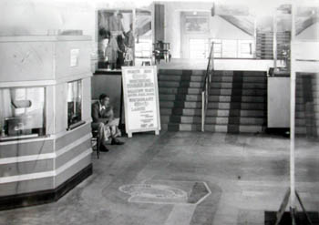 Main foyer of the Swimming Stadium 1934/5. The centre piece to the large entrance in West Street were the two Art Deco brass banisters inlaid with diving ladies dominating the stairway. The main foyer was a model to the latest in fashion design with its pastel colours and beautiful inlaid floors. The main feature being a large motif of the S.S. Brighton life belt inlaid in the centre of the floor.