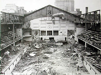 This photograph shows the demolition of the Sports Stadium West Street in the latter part of 1965/6. The view looking west shows Sussex Heights clearly in the background and to the far left is the Metropole Hotel. The old swimming pool installed in 1934 is quite clearly visible and so are the portholes around the inside of the pool. The Swimming Stadium was transformed into an ice rink in the October of 1935. Ironically thirty years later when the workmen were tearing up the floor, the original scaffolding had not moved an inch. Considering it was only put up as a temporary measure in 1935, it showed the workmen had done an excellent job initially in securing the scaffolding. | Photo from the private collection of Trevor Chepstow