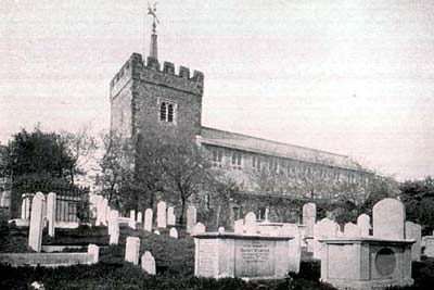 Who is buried in St Nicholas Churchyard?