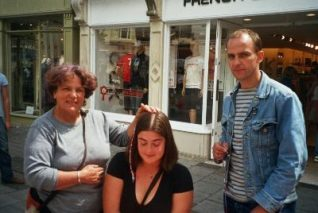 Brad and Chris (hair braiders, mother and son), working on East Street | Photo taken by Zoe Bradford