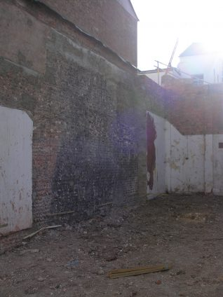 The old flint wall of the Embassy Cinema. | Photo by Peter Groves