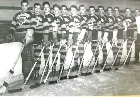 Brighton Tigers Ice Hockey Club, 1937-38. Left to right: Aurelle Bordeleau, Tom Forgie, Jimmy Kelly, Joe Doyle, Al Rogers, Sid Wright, Merrick Cranston, Van Gibson, Oscar Aubuchon, Gordie Poirier, Johny Hamilton, Don Grant, Billy Boucher (coach) | From the SS Brighton Archive