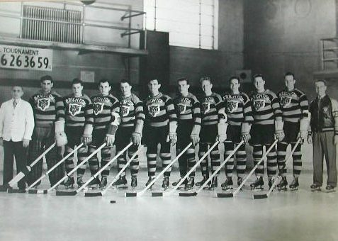 Brighton Tigers Ice Hockey Club, 1938-39.  Left-right: Bill Hawkins (trainer), Aurelle Bordeleau, Joffre Sequin, Tommy Forgie, Sid Wright, Farrand Gillie, Oscar Aubuchon, George Green, Gordie Poirier, Don Grant, Ab McDonald, Billy Boucher (coach) | From the SS Brighton Archive