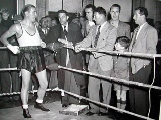 A regular visitor to the Sports Stadium this photograph shows Tommy training for his come back fight and is seen chatting to visiting members of the famous