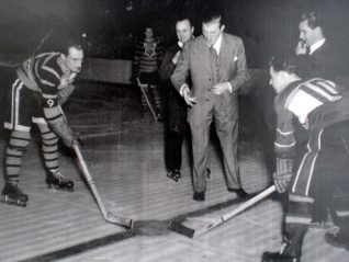 Tommy Farr drops the puck for the face off. Tigers v Streatham | From the private collection of Trevor Chepstow