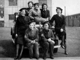 Wrens from HMS Caroline, pictured at Pollock dock, Belfast - Peggy is sat on the bumper (right) | From the private collection of  Mrs. Margaret Smith