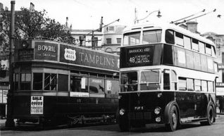 Image shows the Aquarium terminus, with Tram #25 on the Ditchling Road Route 'D' and Brighton Corporation Trolleybus #5 on Route 48 [previously Tram Route 'L'] bound for Lewes Road. | Image from the picture gallery of John King, reproduced with permission from the David Bradley Online website.Tram and Trolley bus at the Aquarium