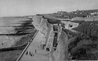 Strollers enjoying the under cliff walk at Ovingdean Gap in 1935; note the camping ground in the field opposite (what is now ) St, Dunstan's. Roe dean School can be seen on the horizon | Photo: Jennifer Drury collection.