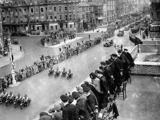 The outriders at the head of the Victory Parade through Hove pass the front of HMS King Alfred in May 1945. Officers and guests gather to watch the parade from the roof of Hove Marina. | Image and caption reproduced with kind permission from Brighton and Hove in Pictures by Brighton and Hove City Council