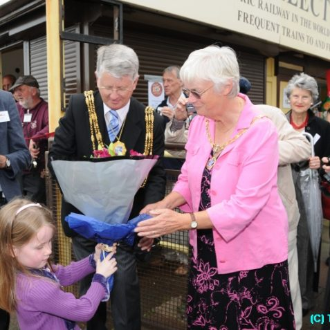 The Mayoress, Mrs Chip Peltzer Dunn, is presented with a bouquet from one of the youngest of the Volks descendants | Photo by Tony Mould