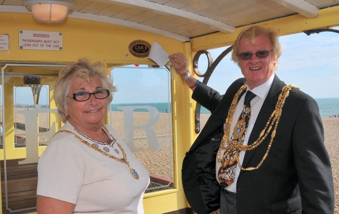 The Mayor Councillor Geoffrey Wells, accompanied by the Mayoress Mrs Sally Wells, reveals the commemorative plaque on car number 9