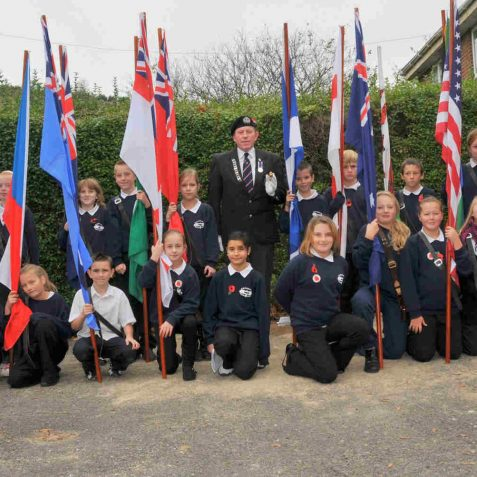 Parade Marshall Mr Tony Avery and the Whitehawk Primary School standard bearers | Photo by Tony Mould