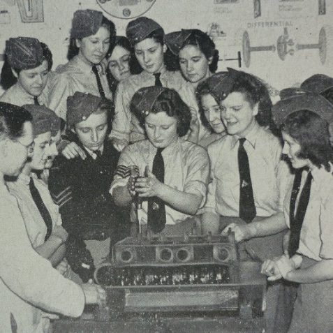 Woman's Junior Air Corps learning motor maintenance | Photo from the 1946 book,