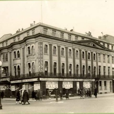 Needham's Closing Down Sale, c. 1930: Needham's closing down sale with pedestrians and ornate street lamps in a traffic free Castle Square. Needham's department store occupied 14-18 Castle Square and 57-58 Old Steine. It was demolished in 1930 and Electric House was built on the site. | Image reproduced with kind permission from Brighton and Hove in Pictures by Brighton and Hove City Council