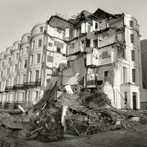 Demolition of Percival Terrace, 1987: On 13 November 1987 the front of 10 Percival Terrace collapsed as a large crater opened up in front of the house. No. 9 has now also been demolished. The 10 five-storey bow-fronted houses in Percival Terrace were built in 1845-50 by Cheeseman's for W. Percival Boxall of Belle Vue Hall. Photograph Copyright Evening Argus. | Image reproduced with kind permission from Brighton and Hove in Pictures by Brighton and Hove City Council
