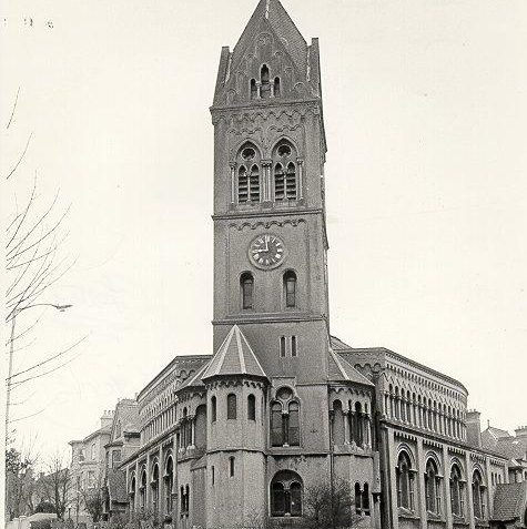 Dials Congregational Church, 1971: Dials Congregational Church, at the corner of Dyke Road and Clifton Road, was built in 1871 by Thomas Simpson. In Romanesque style, it had a horseshoe-shaped auditorium and a 150 foot clock tower which was a prominent landmark. The church was demolished in April 1972 and Homelees House was erected on the still vacant site in 1985-6. | Image reproduced with kind permission from Brighton and Hove in Pictures by Brighton and Hove City Council