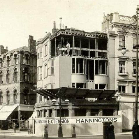 Hanningtons Extension, c. 1930: Builders working on the new extension to Hanningtons department store. Two types of ornate lamppost. | Image reproduced with kind permission from Brighton and Hove in Pictures by Brighton and Hove City Council