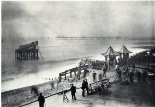 Damaged Chain Pier, 1896: The Chain Pier was damaged by the storm in 1896 and in this photograph the Palace Pier, which was then under construction, can be seen in the background.   Image reproduced with kind permission from Brighton and Hove in Pictures by Brighton and Hove City Council