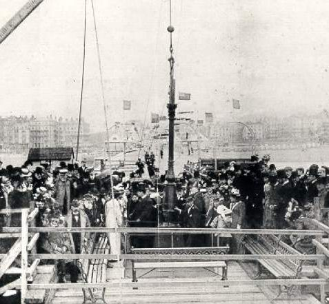 Public on the Palace Pier, 24 May 1899: Crowd gathered on the Palace Pier, at a ceremony to mark the fixing of the first column at the pier head on 29 May 1899. This extension was built to accommodate the theatre, which opened in 1901. | Image reproduced with kind permission from Brighton and Hove in Pictures by Brighton and Hove City Council