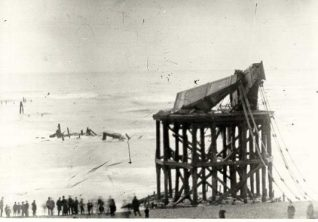 Ruins of The Chain Pier, c. 1896: Ruins of the Chain Pier with a crowd of onlookers on the beach. | Image reproduced with kind permission from Brighton and Hove in Pictures by Brighton and Hove City Council