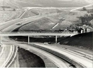 Construction of the Bypass, c. 1988: Construction of the bypass with construction workers and machinery. Photograph Copyright Evening Argus. | Image reproduced with kind permission from Brighton and Hove in Pictures by Brighton and Hove City Council