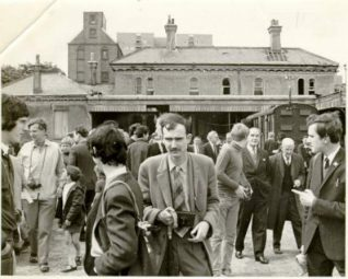 Kemp Town Station, c. 1970: Crowds outside dilapidated Kemp Town Station. | Image reproduced with kind permission from Brighton and Hove in Pictures by Brighton and Hove City Council
