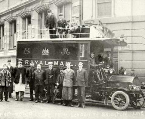 The First Motor Coach from London to Brighton, 1905: The first motorised mail coach from London to Brighton. Picture taken outside post office in Ship Street with driver and post office workers. | Image reproduced with kind permission from Brighton and Hove in Pictures by Brighton and Hove City Council