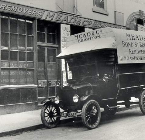 Removal Van, c. 1920s: Removal van belonging to Mead and Co. outside the company's premises in Bond Street. Photograph Copyright Evening Argus. | Image reproduced with kind permission from Brighton and Hove in Pictures by Brighton and Hove City Council