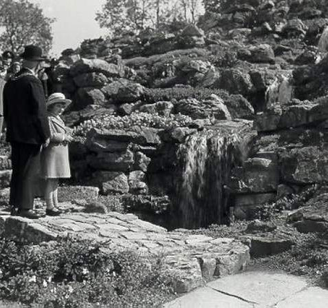 The Rockery, c. 1935: A dignitary and small girl preside over the opening of Preston Park Rockery. | Image reproduced with kind permission from Brighton and Hove in Pictures by Brighton and Hove City Council