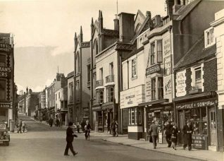 View up Church Street past New Road and the Central National School on the right, demolished in 1971 before the protection order was received during a postal strike. | Image reproduced with kind permission from Brighton and Hove in Pictures by Brighton and Hove City Council
