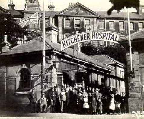 Group under sign at entrance of Kitchener military hospital c. 1917. | Image reproduced with kind permission from Brighton and Hove in Pictures by Brighton and Hove City Council