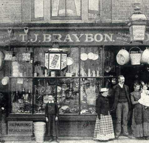 T.J. Braybon, East Street, 1897: T.J. Braybon, gas fitter and plumber's shop at 106, East Street in 1897. Family stand in doorway | Image reproduced with kind permission from Brighton and Hove in Pictures by Brighton and Hove City Council