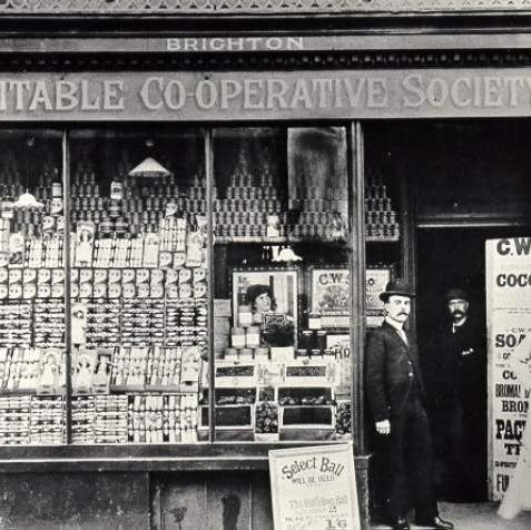 Equitable Co-operative Society, 1888: North Road Co-op with staff posing in the doorway. The store at 32 North Road opened in May 1888. | Image reproduced with kind permission from Brighton and Hove in Pictures by Brighton and Hove City Council