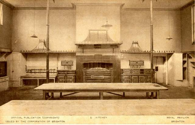 Royal Pavilion kitchen before restoration with its ovens, cupboards and tables.   Image reproduced with kind permission from Brighton and Hove in Pictures by Brighton and Hove City Council