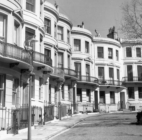 Powis Square, c. 1950s: View of Powis Square facades with motor cycle and side car in foreground. | Image reproduced with kind permission from Brighton and Hove in Pictures by Brighton and Hove City Council