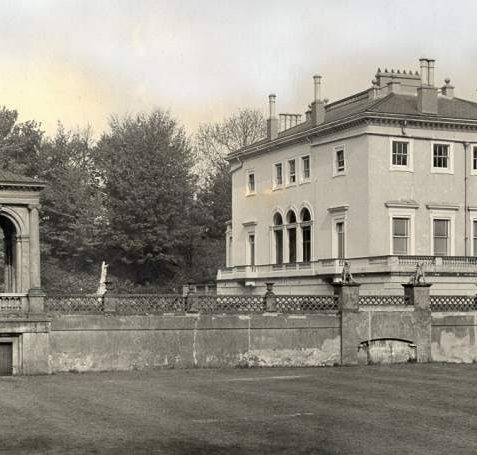 Attree Villa, c. 1940s: The villa of Thomas Attree in Queen's Park. The villa was designed by Charles Barry (best known for his design of the Houses of Parliament) and completed in 1830. It was used as an Xavarian College for Catholic boys from around 1909-1966 but after the college closed in 1966 the villa became dilapidated and it was demolished in March 1972 despite being classed as outstanding and listed Grade 2. The garden temple pictured to the left of the villa survives, opposite the Carn Court flats. | Image reproduced with kind permission from Brighton and Hove in Pictures by Brighton and Hove City Council