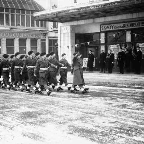 Soldiers marching past the Mayor and other dignitaries outside the Savoy Cinema on Brighton seafront. C.1945 | Image reproduced with kind permission from Brighton and Hove in Pictures by Brighton and Hove City Council