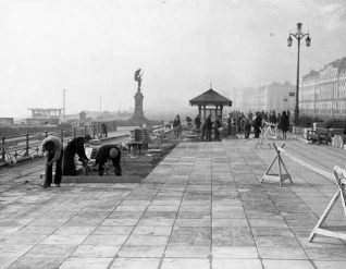 Laying Paving, c. 1940: The twin-pendant strett lamps on the King's Road can be seen in this picture. | Image reproduced with kind permission from Brighton and Hove in Pictures by Brighton and Hove City Council