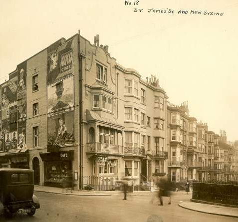 St. James' Street and New Steine, c. 1920s: Junction of St. James' Street and New Steine showing a variety of balconies, advertising hoarding and a car in the foreground.   Image reproduced with kind permission from Brighton and Hove in Pictures by Brighton and Hove City Council