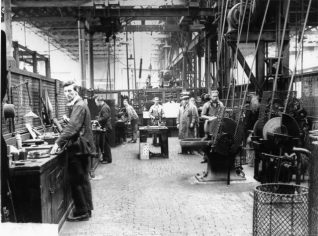 Brighton Railway Works, 1928: At its peak in 1891, Brighton Railway Works employed 2,651 people building, painting and maintaining locomotives and carriages for the London, Brighton and South Coast Railway. Following the formation of Southern Railway in 1923, the workshops focussed on repair work, but during and after the Second World War steam and later diesel-electric locomotives were built, the last on 30 March 1957. The works closed in 1958 and were demolished in 1969. | Image reproduced with kind permission from Brighton and Hove in Pictures by Brighton and Hove City Council