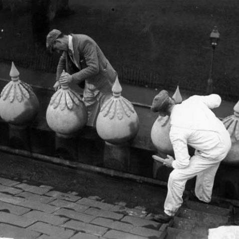 Cleaning Minarets on Pavilion Roof, c. 1930: Men cleaning stone minarets with brushes on the roof of the Royal Pavilion. | Image reproduced with kind permission from Brighton and Hove in Pictures by Brighton and Hove City Council