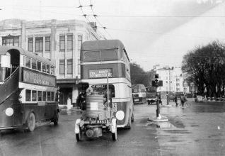 Bus Towing a Gas Producer, c. 1940s: Bus running the 13B service to North Moulscombe (now usually spelt Moulsecoomb). From 1943 several buses operated with trailers producing gas from coal, which was used to run a gas turbine engine to save use of electricity or petrol. Ahead, a trolley bus can be seen. | Image reproduced with kind permission from Brighton and Hove in Pictures by Brighton and Hove City Council