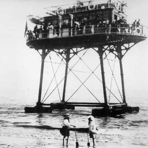 Volk's Sea Going Car at Low Tide, c. 1900: Two girls looking up at the Pioneer, Magnus Volk's Sea Going Car. Also known as the