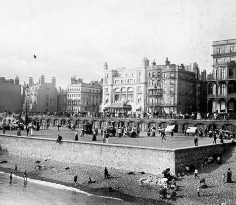 Brighton Beach, c. 1905: Brighton Beach with arches underneath King's Road. At this time part of the beach was raised behind a sea wall, providing a flat surface for promenading. The Bedford Hotel can be seen on King's Road. | Image reproduced with kind permission from Brighton and Hove in Pictures by Brighton and Hove City Council