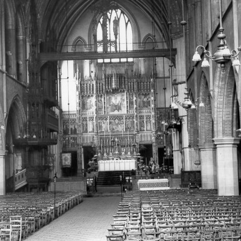 Interior of St. Martin's Church, 1935: The Interior of St. Martin's Church was designed by George Somers Clarke, who also built the church in 1872-75. There is a clerestoried nave sixty-nine feet high, aisles, chancel and an eastern chapel. Behind the altar is a large reredos by H. Ellis Wooldridge of 20 pictures and 69 statuettes. The roof panels are painted with representations of colonial and American sees. | Image reproduced with kind permission from Brighton and Hove in Pictures by Brighton and Hove City Council
